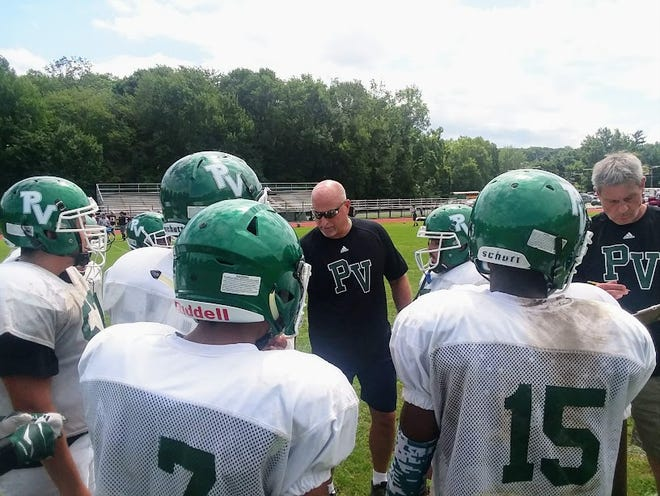 Passaic Valley football coach Chet Parlavecchio instructing his players.