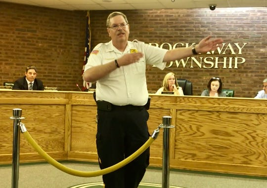 Rockaway Township Police Chief Martin McParland asks an angry crowd to leave the Aug. 22 Rockaway Township Council meeting.
