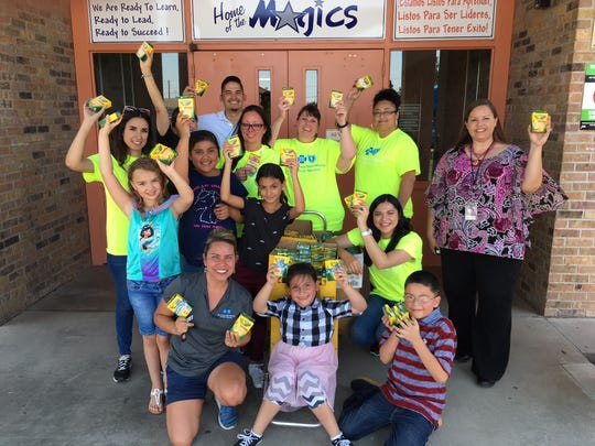 Employees at Blue Cross and Blue Shield of New Mexico delivered school supplies to MacArthur Elementary in Las Cruces on Tuesday, Aug. 14.