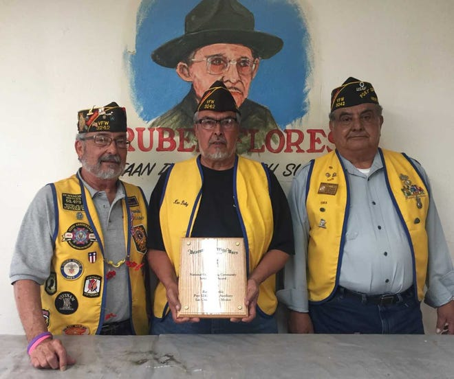VFW Post 3242 members, from left, Commander Jimmy Jaramillo; Adjutant  Bobby Martinez; and Quartermaster Marty Martinez, pose with a plaque the post received for being the 2018 National Outstanding Community Service Post.