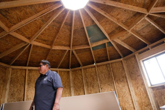 Navajo Nation Speaker LoRenzo Bates tours the interior of a newly constructed hogan Tuesday in Ch'ooshgai Mountain's Naschitti Chapter area.