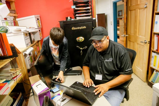GreenBridge Computing Inc. intern James Yunger, left, and Choice NTUA Wireless solution architect Christopher Curley work on setting up Internet services Thursday at the Shiprock Chapter house.
