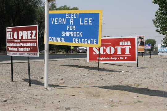 Campaign signs are posted Thursday in front of the Shiprock Chapter house.