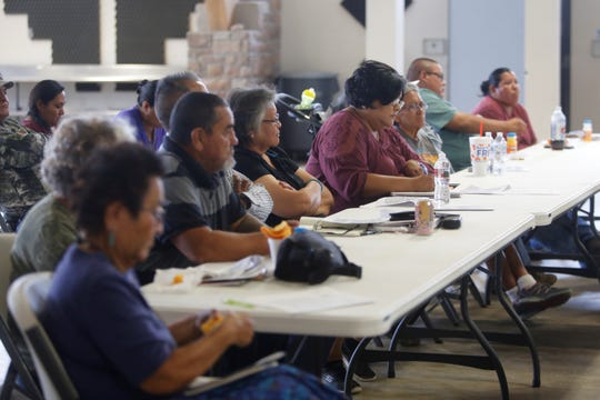 Audience members listen Wednesday during a Navajo Nation Department of Agriculture presentation in Nenahnezad regarding use of a payment received from insurance the tribe acquired in 2016.