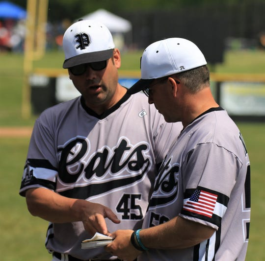 Plymouth baseball assistant coaches Beau Adams (left) and Scott Niemiec were essential to the success the past five seasons under Alma College-bound head coach Jason Crain.
