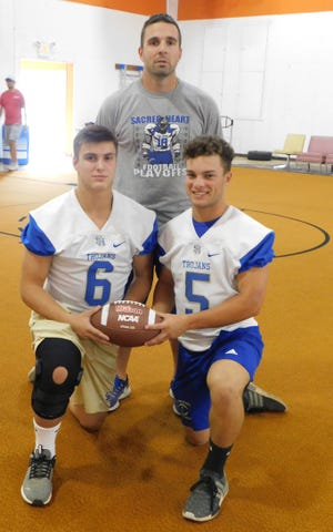Sacred Heart football standouts JT Harper (8) and Wesley Launey (5) appear with Trojans' head football coach during a photo day picture taken this month. The Trojans are running a Veer offense which will make a debut on Friday night during the Evangeline Parish Jamboree at Ville Platte High.