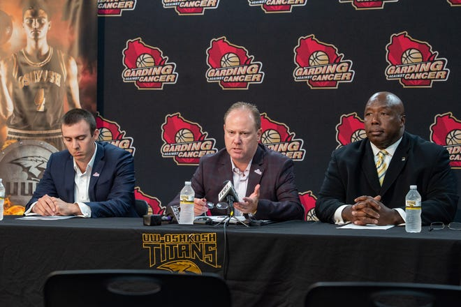 UW-Oshkosh interim head coach Matt Lewis, left, Wisconsin head coach Greg Gard and UW-Oshkosh assistant chancellor and director of athletics Darryl Sims, right, talk about the Garding Against Cancer fundraiser during a news conference Thursday in Oshkosh.