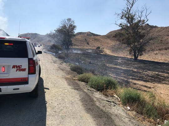 CalFire/Riverside County Fire Department personnel were on scene Wednesday as a brushfire broke out along Highway 60 near Beaumont, eventually forcing officials to shut the freeway down.