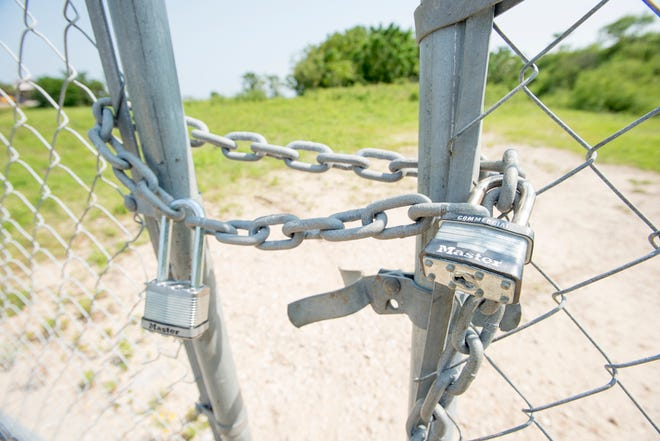 The fence surrounding the entrance to Bruce Beach is locked in Pensacola on Thursday, August 23, 2018.