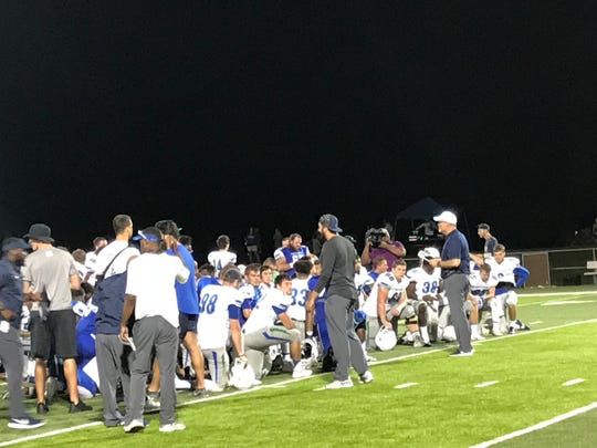 UWF football coach Pete Shinnick meets with his team Wednesday night following the team's final scrimmage of preseason at Pen-Air Field on campus.