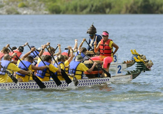 Dragon Boats make their way across Bayou Texar during the Third annual Pensacola Dragon Boat Race and Festival at Bayview Park.