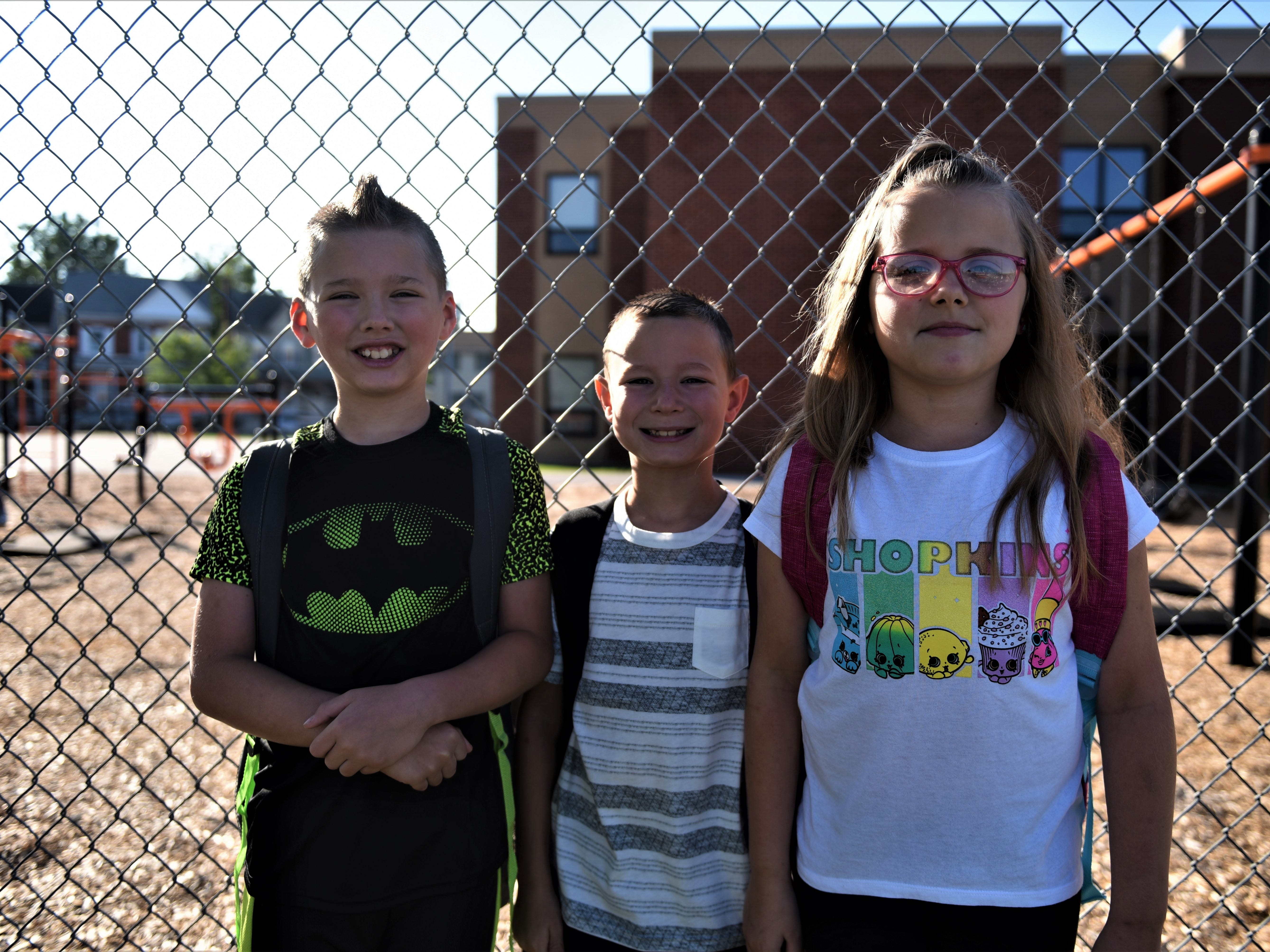 Robby Lauterbach, in the middle, is ready for the first day of first grade. And twins Shawn and Jada Dellinger are starting their first day of third grade at Hanover Street Elementary on Aug. 23.
