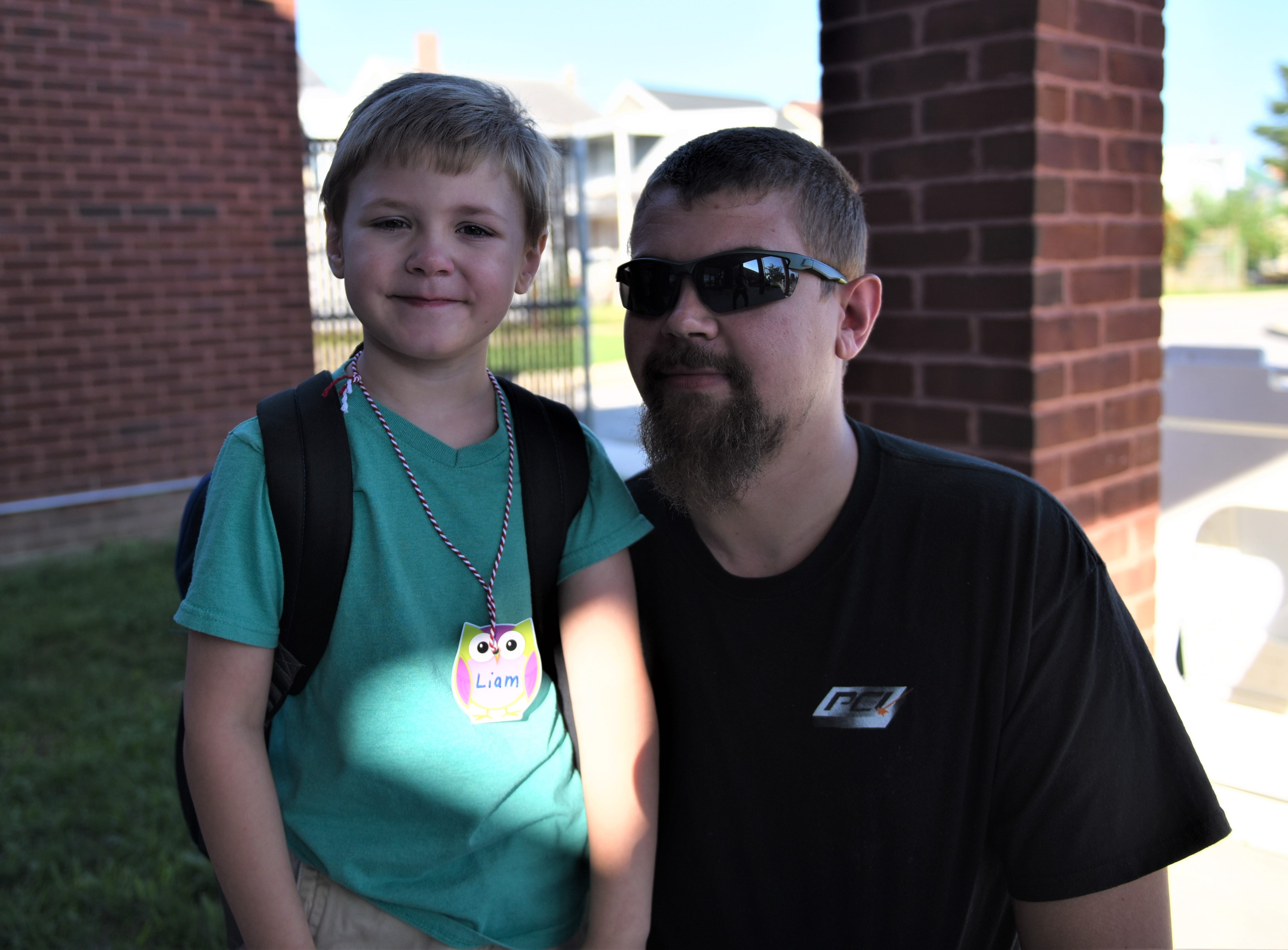 Liam Griffie and his dad were saying goodbye on Liam's first day of kindergarten at Hanover Street Elementary on Aug. 23.