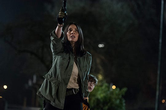 Olivia Munn and Jacob Tremblay in The Predator (2018).