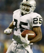 Oakland Raiders running back Charlie Garner runs to the end zone on a 46-yard touchdown pass play against the Tennessee Titans in the second quarter on Sept. 7, 2003, in Nashville, Tennessee.
