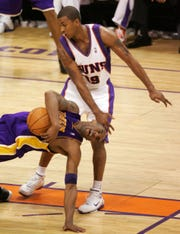 Raja Bell (19) fouls Kobe Bryant during the fourth quarter of a 2006 NBA playoff game.