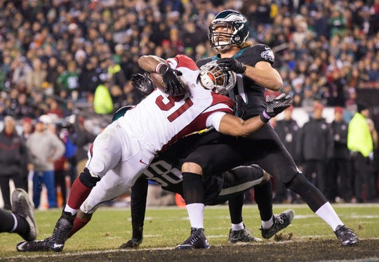 Dec 20, 2015; Philadelphia, PA, USA; Arizona Cardinals running back David Johnson (31) scorers a touchdown past the tackle attempt of Philadelphia Eagles linebacker Kiko Alonso (50) during the third quarter at Lincoln Financial Field.