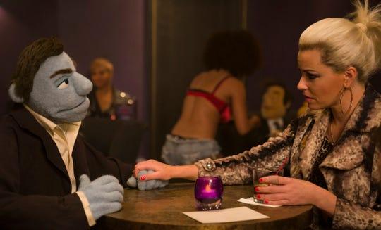 "Elizabeth Banks stars in ""The Happytime Murders."""