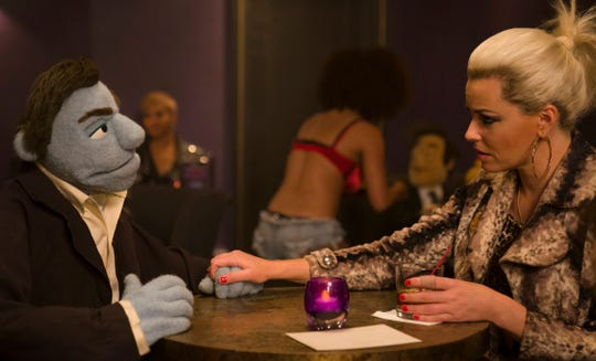 "Elizabeth Banks stars in ""The Happytime Murders."""