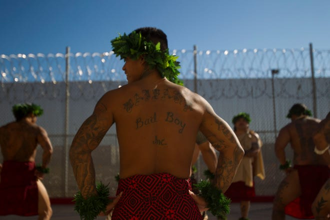 Around 100 inmates participate in a sunrise service wearing their traditional Hawaiian dress during the ceremonies on Oct. 9, 2011, to honor Lono, the Hawaiian god of rain and fertility, at Saguaro Correctional Center in Eloy. The private prison houses inmates from Hawaii serving lengthy sentences.
