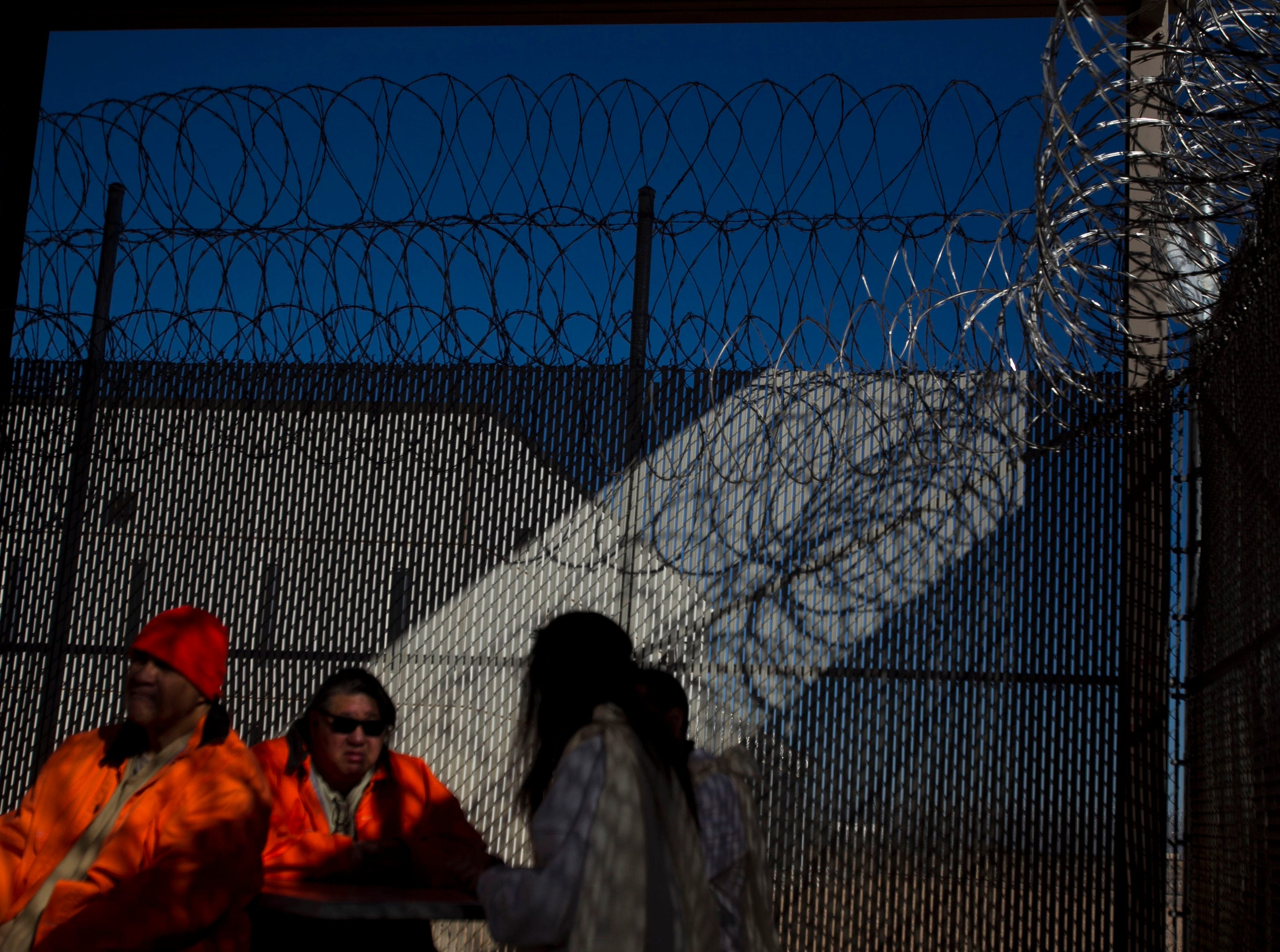 Inmates participate in a sunrise service wearing their traditional Hawaiian dress during the ceremonies on Oct. 9, 2011, to honor Lono, the Hawaiian god of rain and fertility, at Saguaro Correctional Center in Eloy. The private prison houses inmates from Hawaii serving lengthy sentences.
