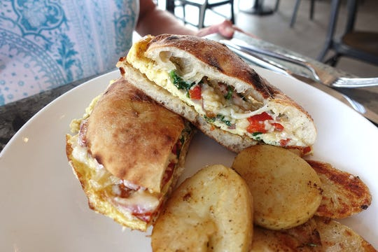 Roasted pepper frittata sandwich with Parmigiano Reggiano, onions and eggs at Roland's Cafe Market Bar.