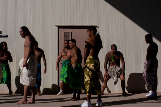 Inmates participate in sunrise services wearing traditional Hawaiian dress during the ceremonies to honor Lono, the Hawaiian god of rain and fertility, at Saguaro Correctional Center in Eloy on Oct. 9, 2011. The private prison houses inmates from Hawaii serving lengthy sentences.