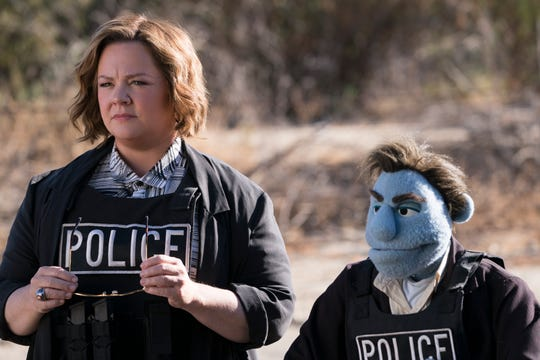 """Melissa McCarthy stars in """"The Happytime Murders"""" with puppet cop Phil Philips (voiced by Bill Barretta)."""