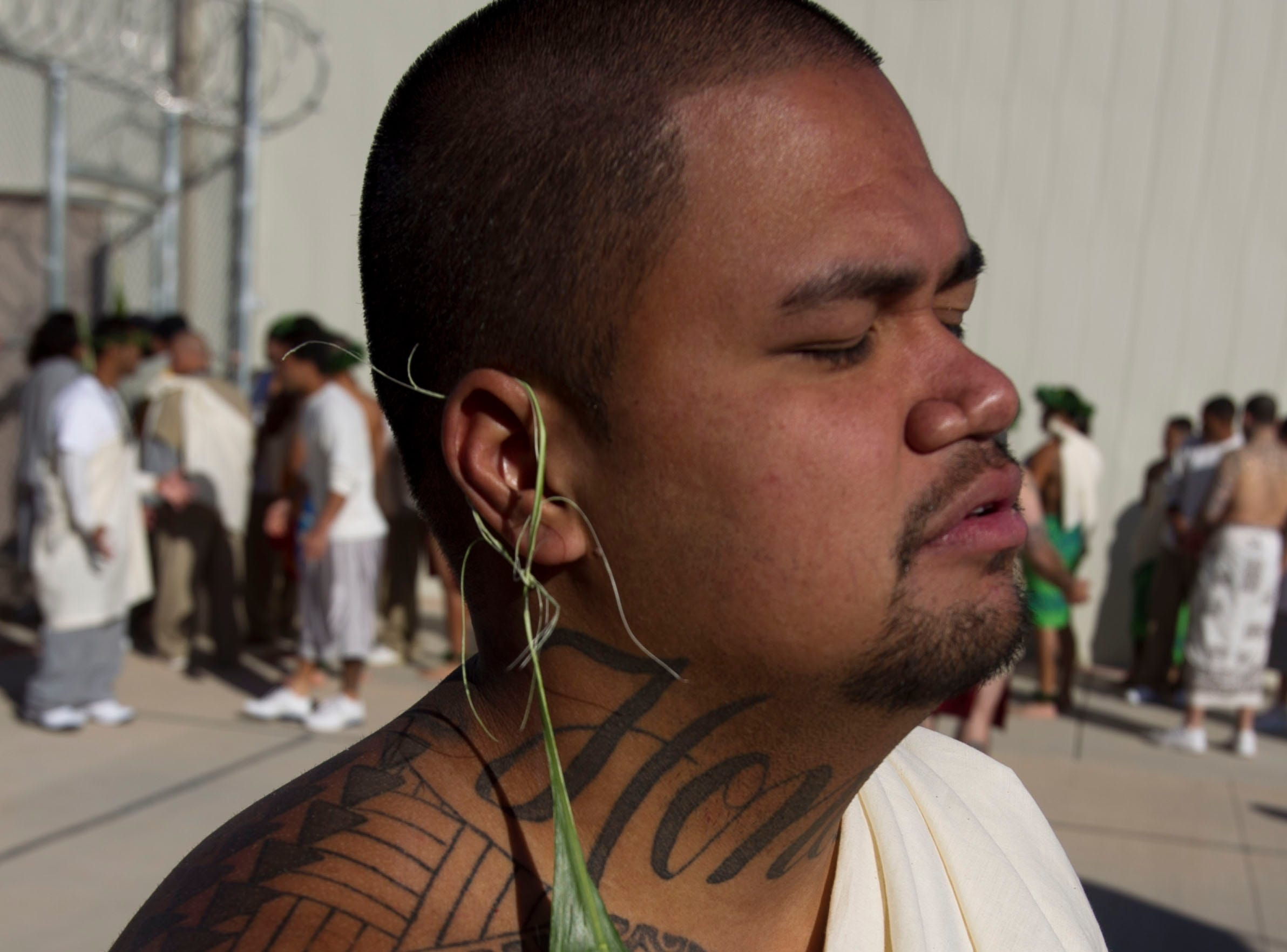 Kelena Neula, a Hawaiian inmate at Saguaro Correctional Center in Eloy, prays for the beginning of the Makahiki season of harvest during sunrise service on Oct. 9, 2011.