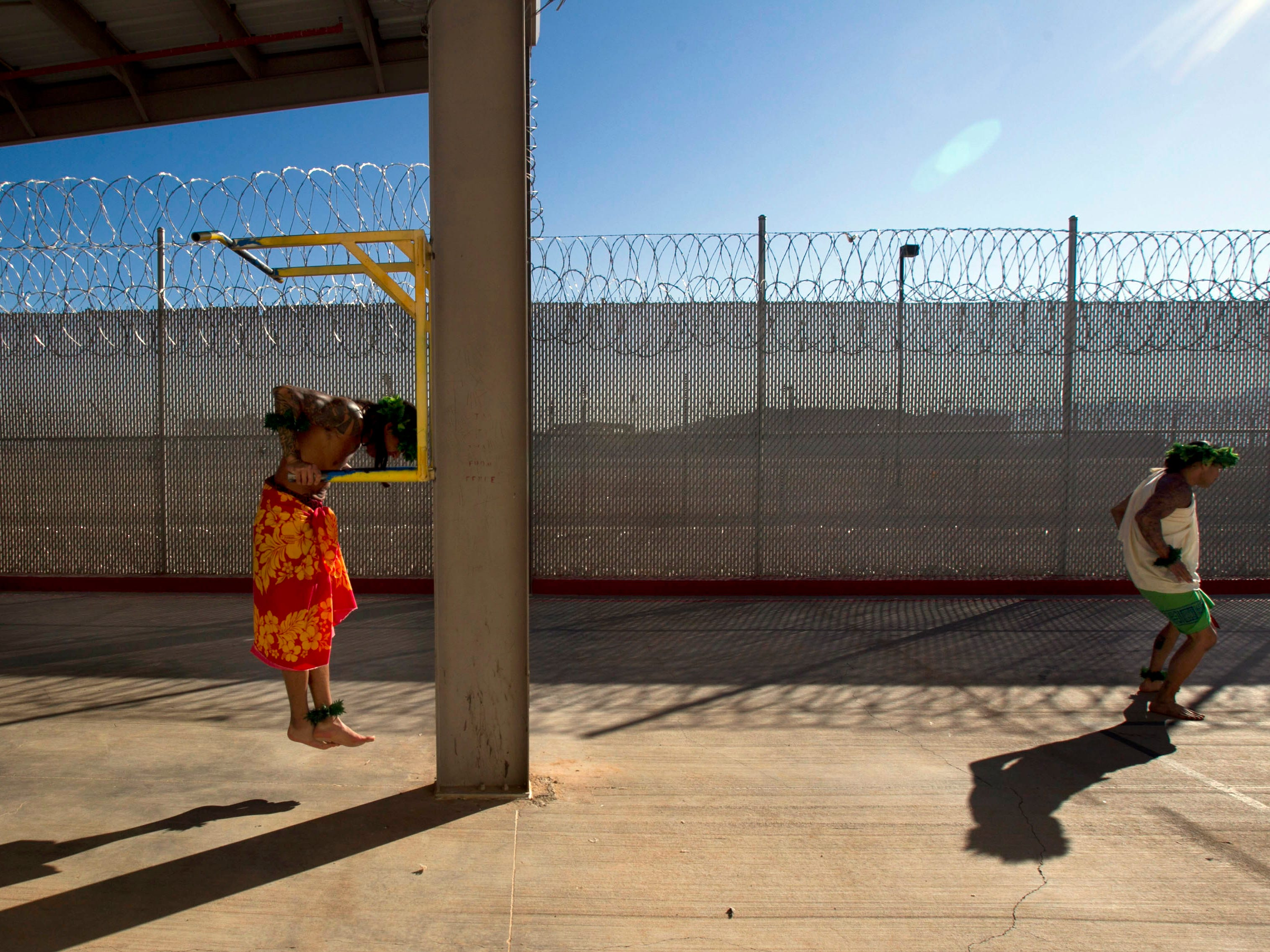 Some inmates from Hawaii exercise while others prepare for a ceremony at Saguaro Correctional Center in Eloy on Oct. 9, 2011. This facility houses inmates from Hawaii serving lengthy sentences.