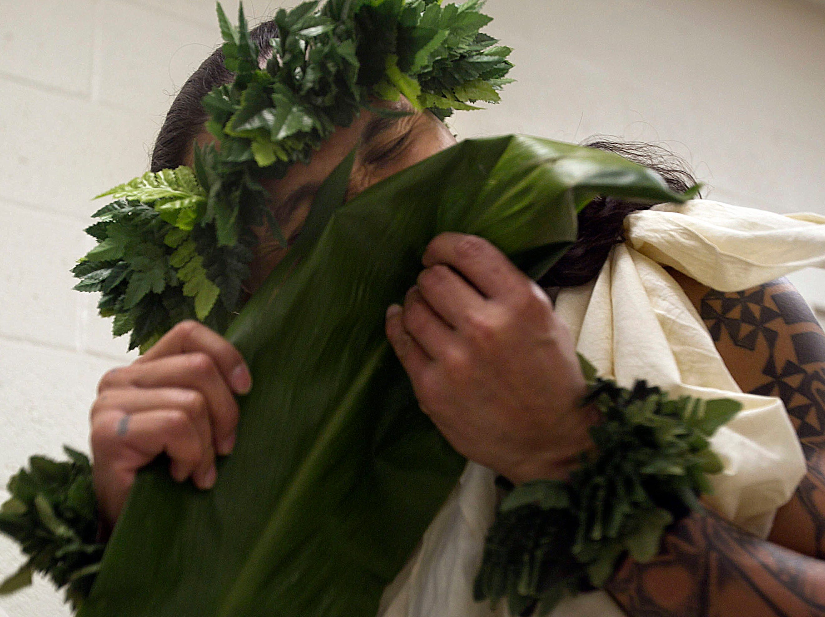 Eugene Ruiz, an inmate from Hawaii at Saguaro Correctional Center in Eloy, prepares for rituals and prayers for the beginning of the Makahiki season of harvest on Oct. 11, 2011.