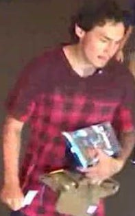 Police say this man flashed a knife at a Target store employee in Phoenix before leaving with unpaid merchandise on August 4, 2018.