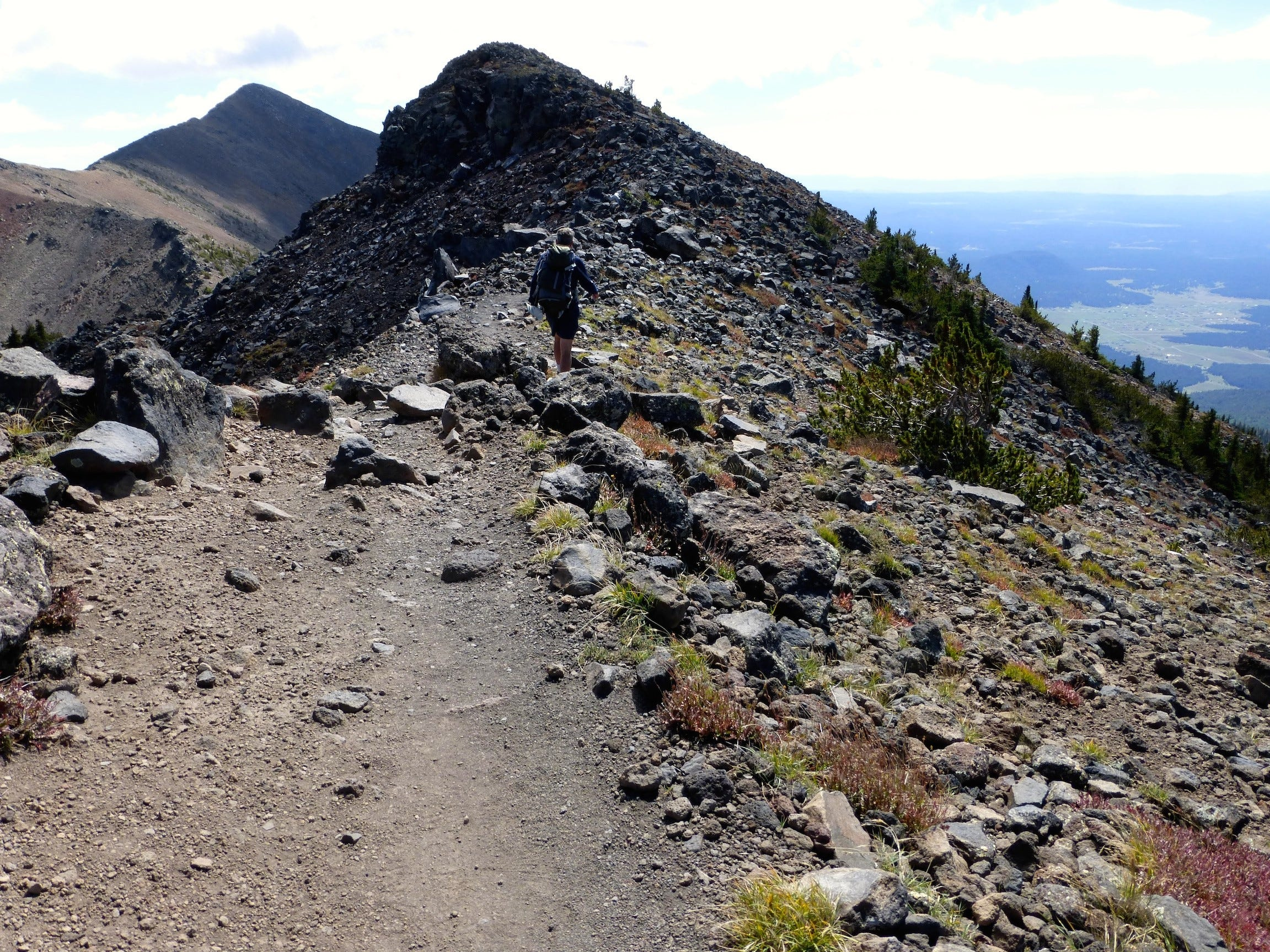 The strenuous trail to the top of Humphreys Peak climbs above the tree line and crosses the only alpine tundra in Arizona.