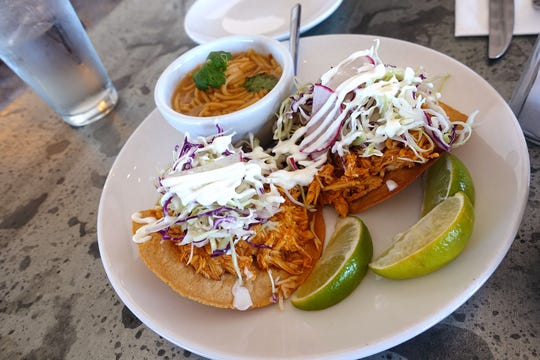 Wood fired tostada with chicken tinga, crema fresca, cabbage, radish, cilantro and fideo soup at Roland's Cafe Market Bar.