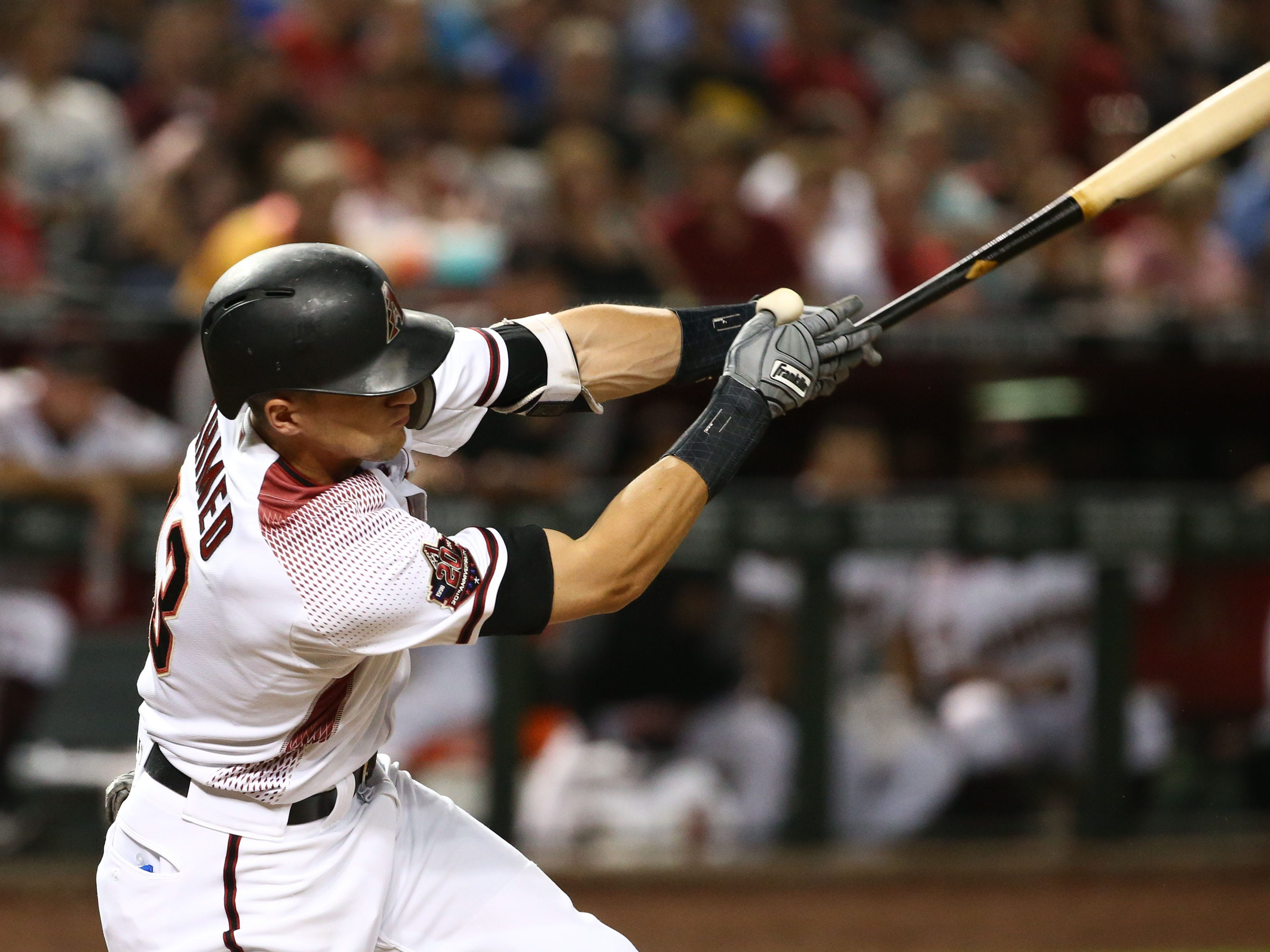 Arizona Diamondbacks Nick Ahmed hits an RBI-single against the Los Angeles Angels in the fourth inning on Aug. 22, 2018, at Chase Field in Phoenix, Ariz.