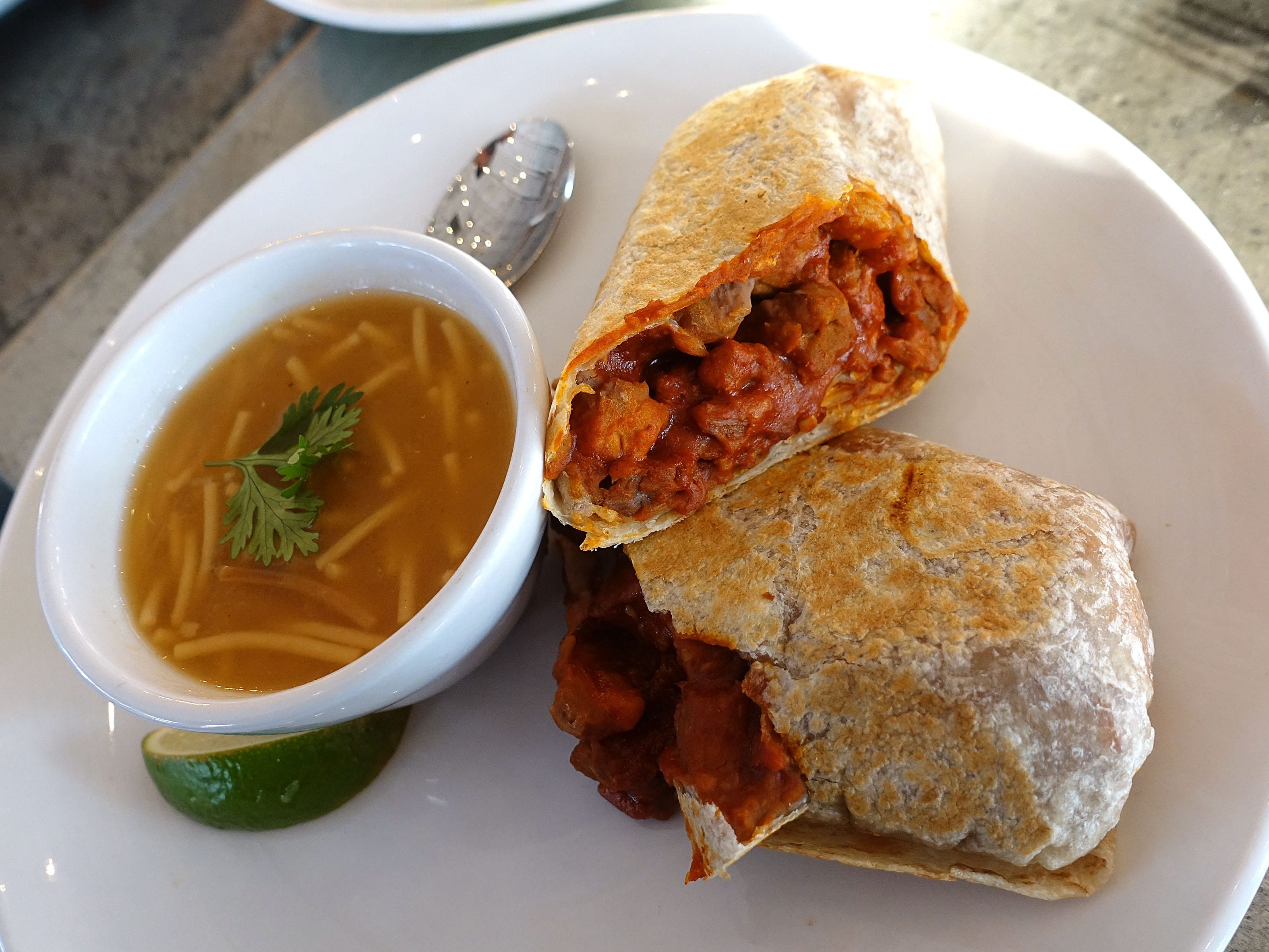 Chile colorado burrito with Niman Ranch pork, refried beans and sopa de fideos at Roland's Cafe Market Bar in Phoenix.