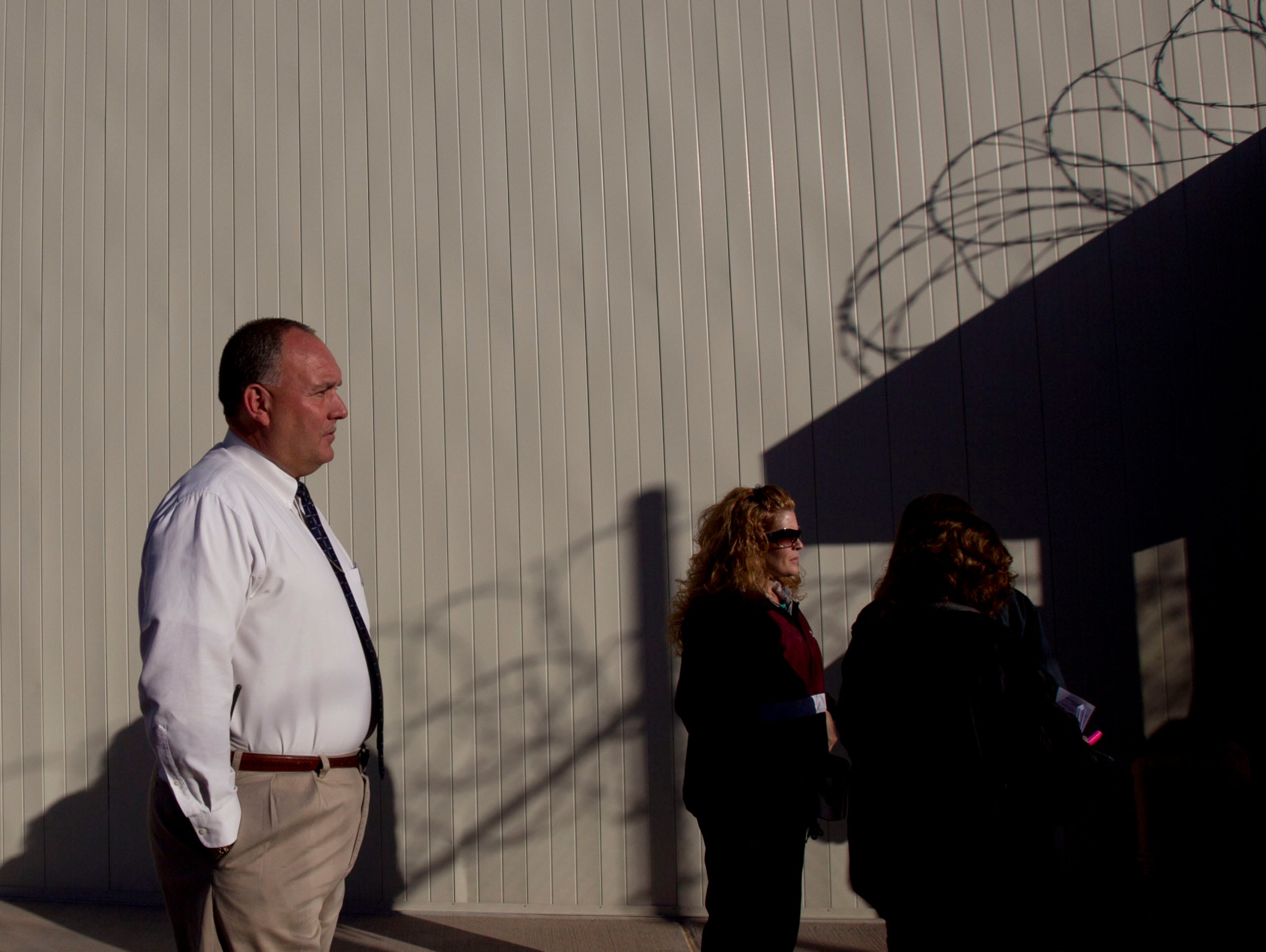 Warden Todd Thomas of Saguaro Correctional Center in Eloy watches the  rituals and prayers of Hawaiian inmates on Oct. 9, 2011.