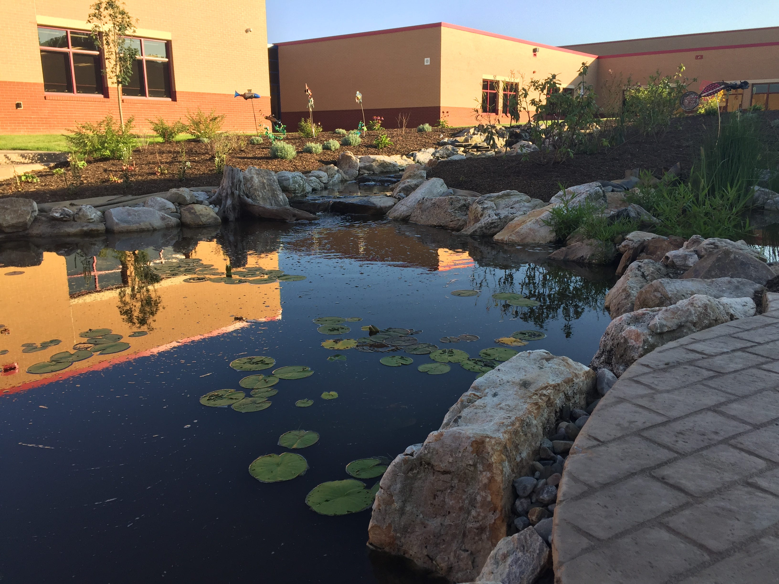 The courtyard and educational pond for life science and biology lessons at the new Northwest Elementary School Aug. 23, 2018. The school's STEAM (science, technology, engineering, art and math) and biology labs both have exits leading to the courtyard pond area.