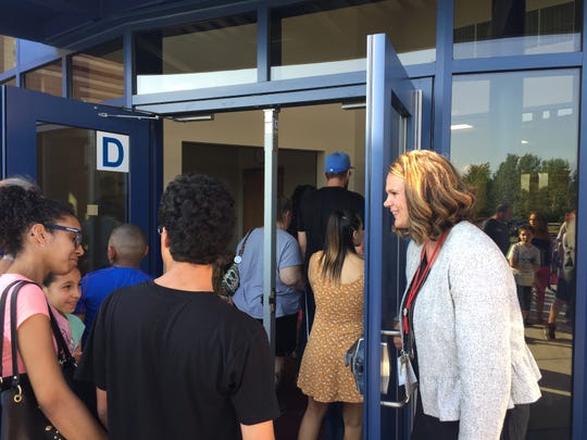 Assistant Principal Jennifer Nordall greets parents and students attending the new Northwest Elementary School open house Aug. 23, 2018.