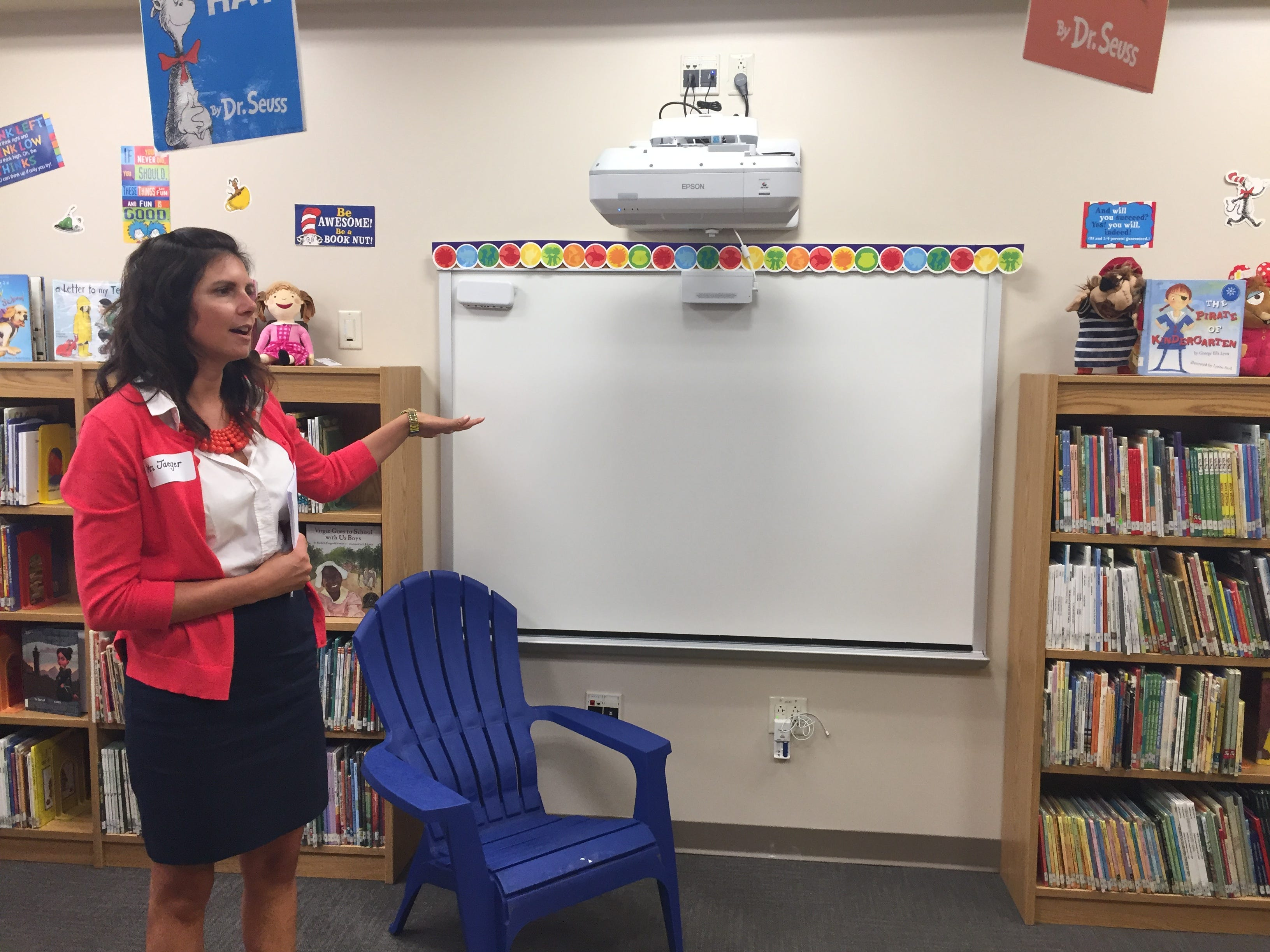 Librarian Lindsey Jaeger discussing the library during an open house in the new Northwest Elementary  School Aug. 23, 2018.
