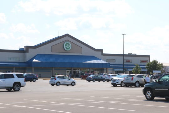On Wednesday, state and federal agents raided Bassett's Market Pharmacy in Portage Township as part of an investigation into a Sandusky doctor.