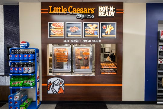 The SpeedyQ at 2797 Wadhams Road added a Little Caesars Express during recent renovations. The kiosk offers an abridged menu of the chan's offerings.
