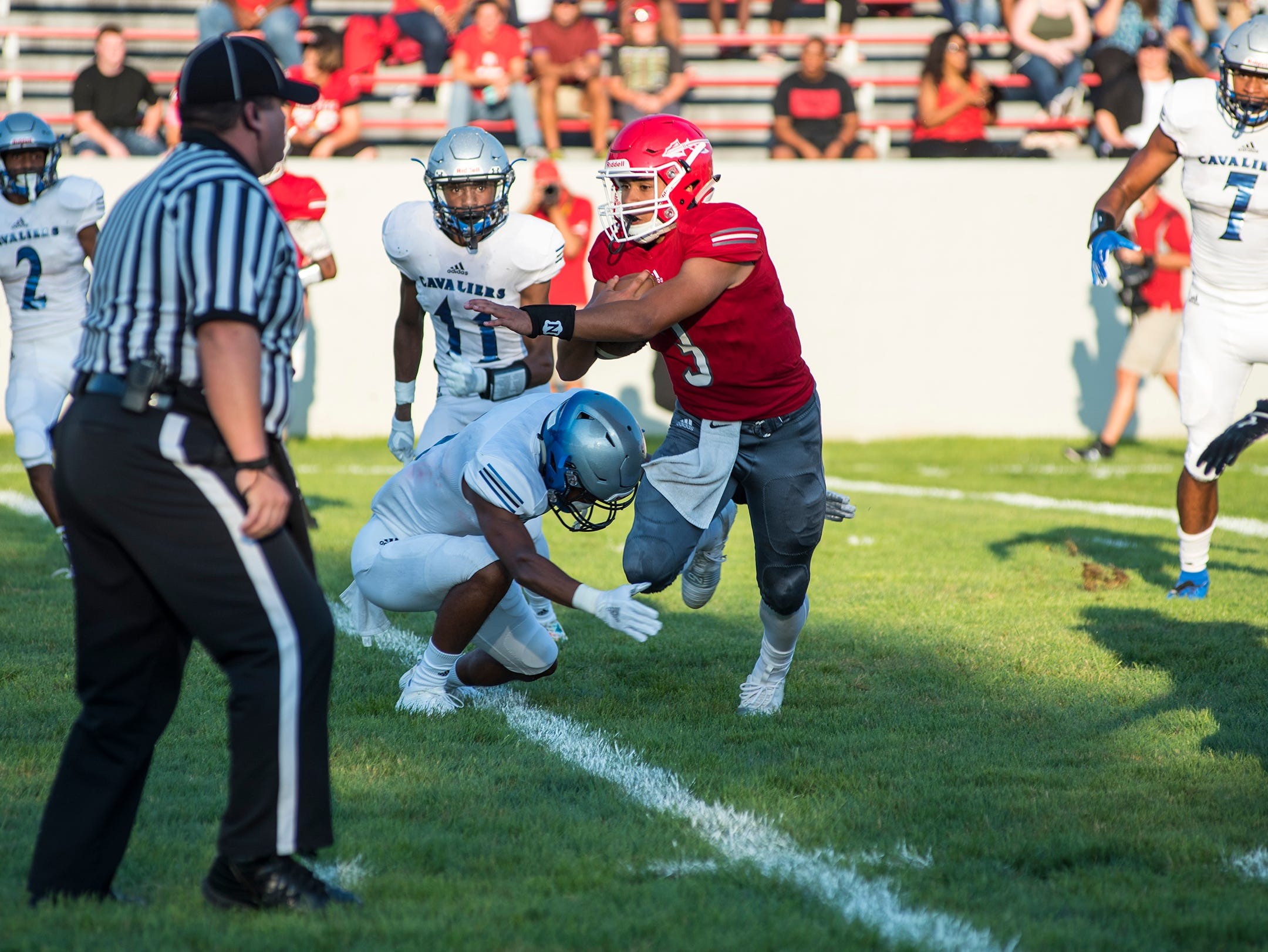 Port Huron High School quarterback Jonny Oriel runs the ball during their game against Carman-Ainsworth High School Thursday, Aug. 23, 2018, at Memorial Stadium.