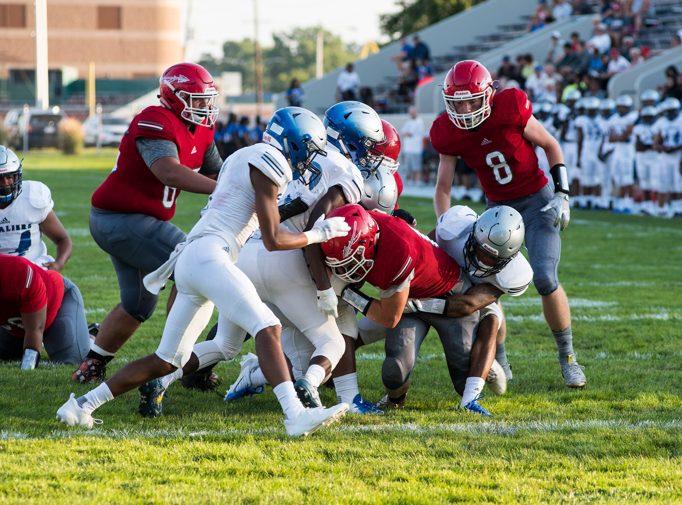 Port Huron High School running back Josh Butler is brought down inside the end zone, giving Port Huron its first touchdown during the Big Reds' game against Carman-Ainsworth High School Thursday, Aug. 23, 2018, at Memorial Stadium.