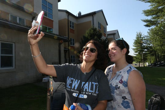 Lana Cuomo of Goshen takes a selfie with her daughter, Gianna during move in day at SUNY New Paltz on August 23, 2018.