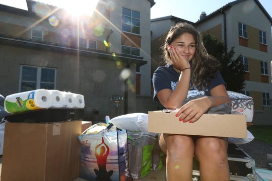 Brianna Mach of Rocky Point waits for Esopus Hall to open during move in day at SUNY New Paltz on August 23, 2018.