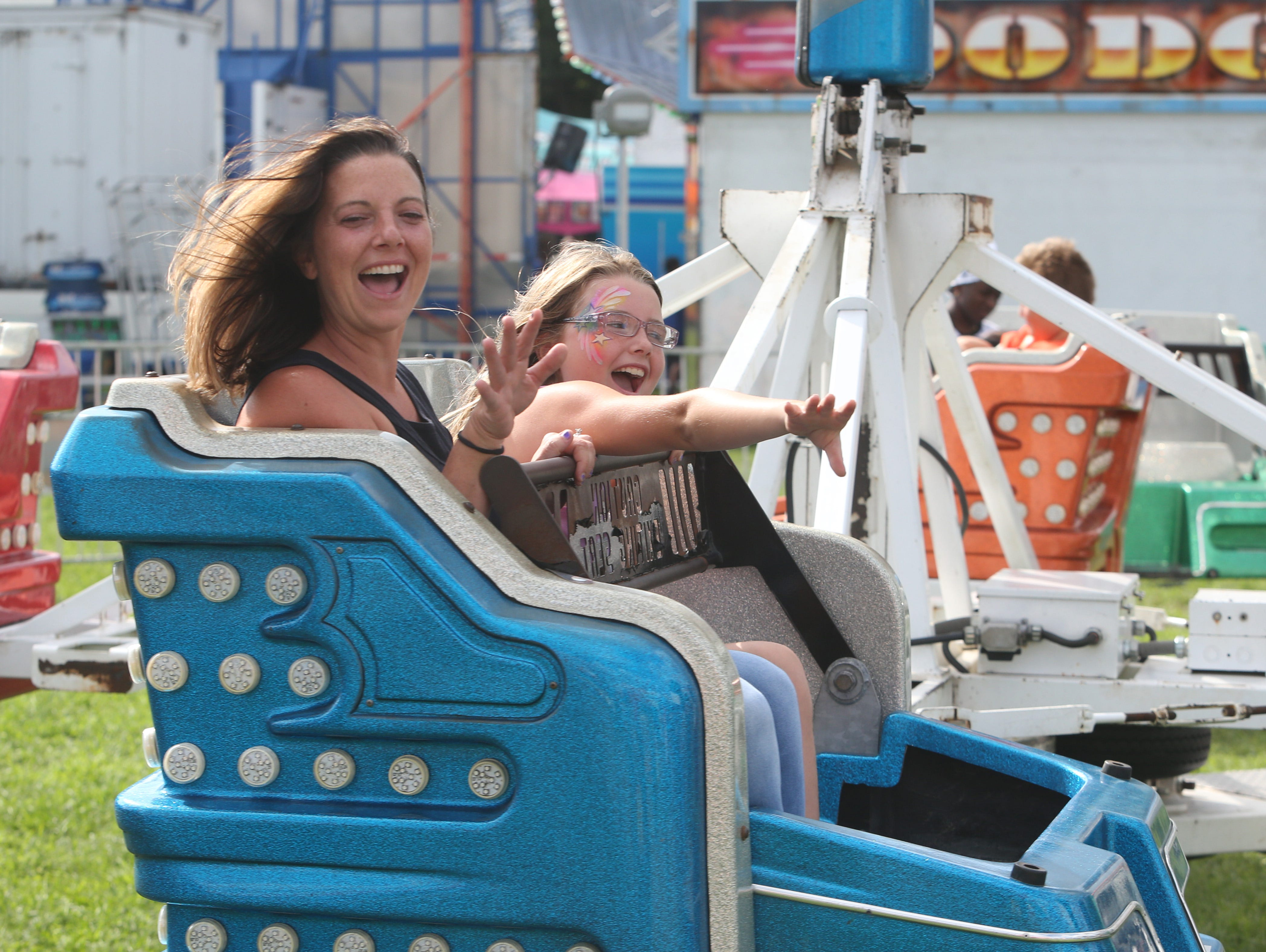 Kelly Schluter rides the Sizzler with her daughter, Hayley, at the Dutchess County Fair on August 21, 2018.
