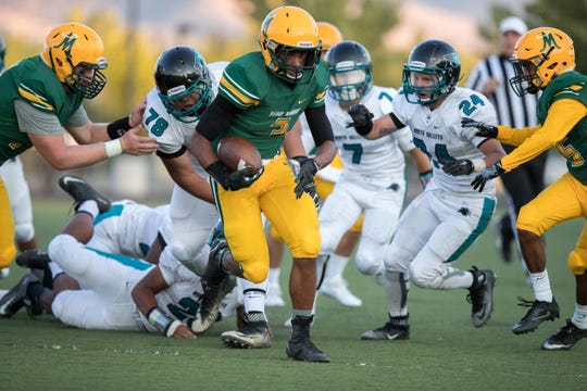 Peyton Dixon picks up a fumble and heads to the end zone against North Valleys.