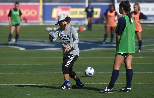 Nevada women's soccer coach Erin Otagaki, middle, gives a player some instruction during practice on Wednesday.
