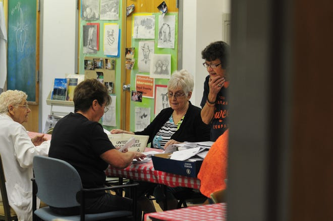 People from Widowed Persons Service work to get newsletters ready to mail on Thursday, Aug. 23, 2018 at the Richmond Senior Community Center.